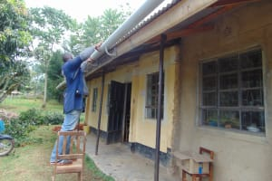 The Water Project: Isikhi Primary School -  Attaching Guttering