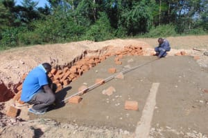 The Water Project: Isikhi Primary School -  Measuring And Brick Setting