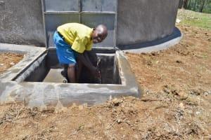 The Water Project: Isikhi Primary School -  A Boy Enjoying Water
