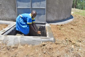 The Water Project: Isikhi Primary School -  A Girl Enjoying Water