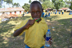 The Water Project: Isikhi Primary School -  A Student Demonstrating How To Brush Teeth