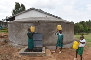 The Water Project: Galona Primary School -  Students Collect Water From The Tank