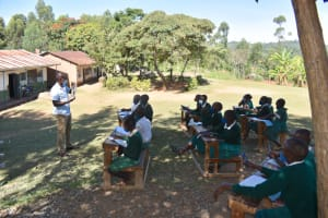 The Water Project: Galona Primary School -  Explaining Solar Disinfection Method Of Water Treatment