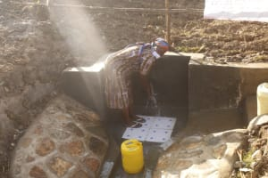The Water Project: Mwitwa Community, Matiang'i Spring -  Community Member Washing Hands Before Fetching Water