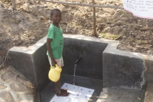 The Water Project: Mwitwa Community, Matiang'i Spring -  George Fetching Water