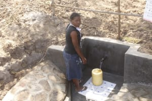 The Water Project: Mwitwa Community, Matiang'i Spring -  Jacinta Mukoya Collecting Water