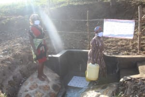 The Water Project: Mwitwa Community, Matiang'i Spring -  People Collecting Water