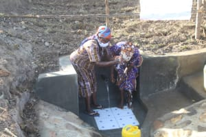 The Water Project: Mwitwa Community, Matiang'i Spring -  People Celebrating By Splashing Water