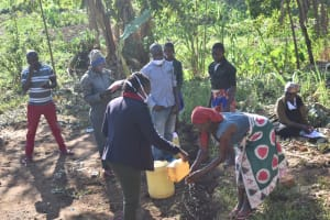 The Water Project: Khaunga A Community, Murutu Spring -  A Community Member Washing Hands