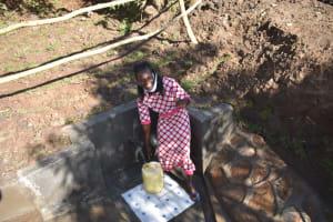 The Water Project: Khaunga A Community, Murutu Spring -  Caroline Amakhongo Fetching Water