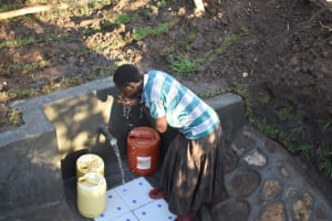 The Water Project: Khaunga A Community, Murutu Spring -  Celestine Quenching Thirst At The Water Point