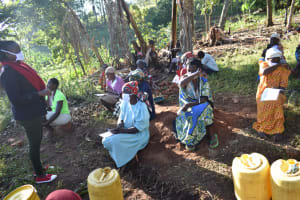 The Water Project: Khaunga A Community, Murutu Spring -  Demonstrating How To Cough Using Bent Elbows