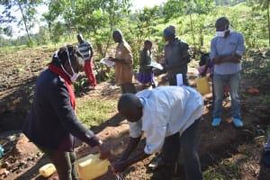 The Water Project: Khaunga A Community, Murutu Spring -  Emmanuel Murutu Washing Hands