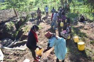 The Water Project: Khaunga A Community, Murutu Spring -  Grace Wanga Demonstrates Handwashing