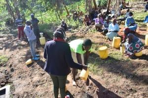 The Water Project: Khaunga A Community, Murutu Spring -  Metrine Demonstrates Handwashing