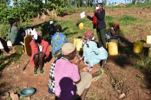 The Water Project: Khaunga A Community, Murutu Spring -  Participants Listening