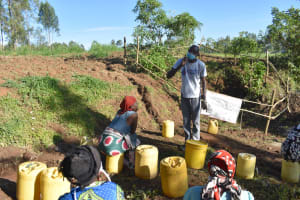 The Water Project: Khaunga A Community, Murutu Spring -  Trainer Protus Demonstrating How To Brush Teeth