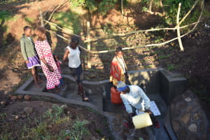 The Water Project: Khaunga A Community, Murutu Spring -  Using Water To Clean The Spring