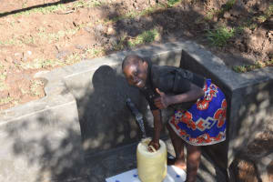 The Water Project: Khaunga A Community, Murutu Spring -  Yvone Fetching Water