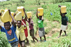 The Water Project: Ematetie Community, Amasetse Spring -  People Carrying Water