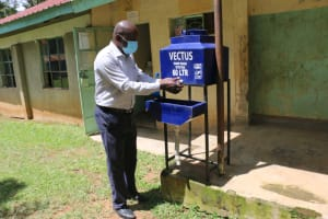 The Water Project: Rise and Shine Special School for the Physically Handicapped -  Teacher Willis Otieno Ooko Washing His Hands