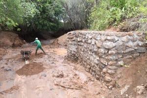 The Water Project: Kangalu Community B -  Hauling Rocks