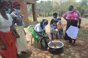 The Water Project: Kangalu Community B -  Mixing Soap
