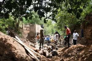 The Water Project: Kangalu Community B -  Working On Dam And Well Site