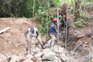 The Water Project: Kangalu Community B -  Building Dam Walis
