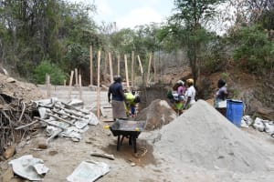 The Water Project: Syonzale Community -  Mixing Sand And Cement