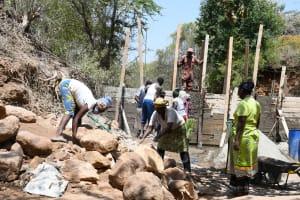 The Water Project: Syonzale Community -  Hauling Rocks