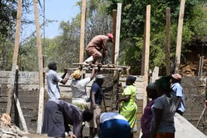The Water Project: Syonzale Community -  Lifting Up Large Rocks For The Dam Walls
