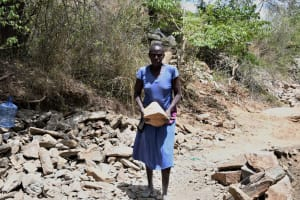 The Water Project: Kaketi Community C -  Carrying A Rock