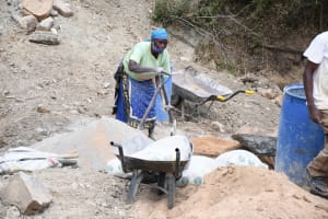 The Water Project: Kaketi Community C -  Mixing Cement And Sand
