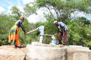 The Water Project: Kaketi Community C -  Fetching Water Form The New Well