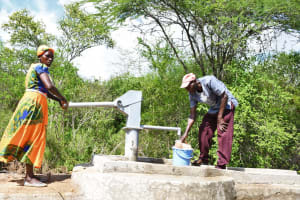 The Water Project: Kaketi Community C -  Filling Up At The Well