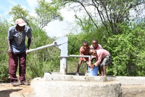 The Water Project: Kaketi Community C -  Children Using Water At The Well