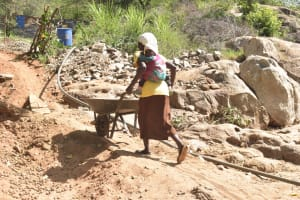The Water Project: Kithalani Community -  Hauling Rocks