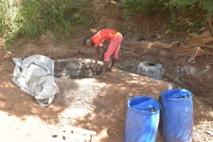The Water Project: Kithalani Community A -  Building Some Of The Well Interior Walls