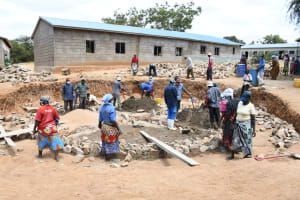 The Water Project: Mung'alu Primary School -  Community Members Work On The Tank Foundation