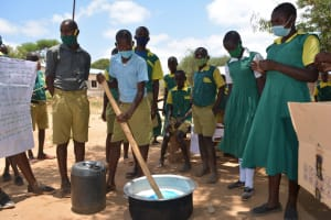 The Water Project: Mung'alu Primary School -  Student Mixes Soap