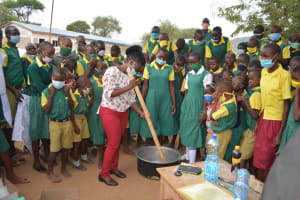 The Water Project: Mung'alu Primary School -  Trainer Shows How To Mix Soap