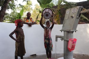 The Water Project: Rosint Community, #24 Poultry St -  Girls Dumping Water In Joy