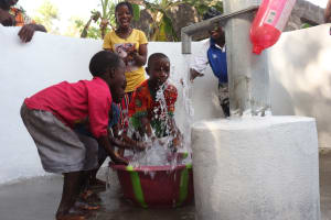 The Water Project: Rosint Community, #24 Poultry St -  Kids Splash Water From The Well