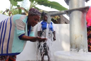 The Water Project: Rosint Community, #24 Poultry St -  Woman At The Completed Well