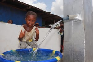 The Water Project: Kamasondo, Borope Village, Main Motor Rd. Junction -  Child Playing With The Water