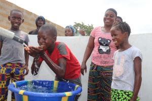 The Water Project: Kamasondo, Borope Village, Main Motor Rd. Junction -  Kids Drinking From The Well