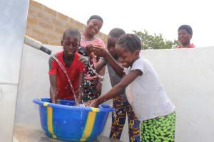 The Water Project: Kamasondo, Borope Village, Main Motor Rd. Junction -  Kids Splashing At The Well