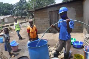 The Water Project: Kamasondo, Borope Village, Main Motor Rd. Junction -  Yield Test