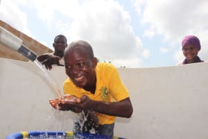 The Water Project: Kamasondo, Borope Village, Main Motor Rd. Junction -  Young Man Drinking Water